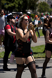 A horn player with the Burlesque Band of San Francisco marches through Golden Gate Park, during the 105th running of the Bay to Breakers 12k, Sunday, May 15, 2016 in San Francisco. The 7.42-mile race from San Francisco Bay to the Pacific Ocean, which attracts a field of tens of thousands of runners, from elite runners to weekend warriors, some clad in costume and some in nothing at all. (D. Ross Cameron/Bay Area News Group)