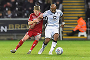 Hayden Coulson (33) of Middlesbrough battles for possession with Andre Ayew (22) of Swansea City during the EFL Sky Bet Championship match between Swansea City and Middlesbrough at the Liberty Stadium, Swansea, Wales on 14 December 2019.