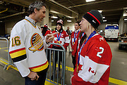 VANCOUVER, BC - MARCH 2:  Trevor Linden, captain of the 1994 Vancouver Canucks talks to Meghan Agosta-Marciano forward for the 2014 Canadian Olympic Women's gold medal hockey team prior to the 2014 Tim Hortons Heritage Classic between the Ottawa Senators and the Vancouver Canucks at BC Place on March 2, 2014 in Vancouver, B.C., Canada.  (Photo by Kevin Light/NHLI via Getty Images)