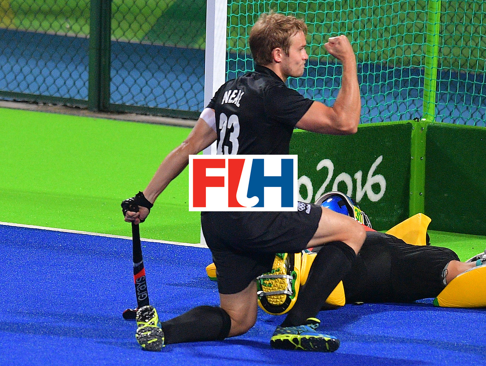 New Zealand's Shay Neal celebrates scoring a goal during the men's field hockey New Zealand vs Brazil match of the Rio 2016 Olympics Games at the Olympic Hockey Centre in Rio de Janeiro on August, 10 2016. / AFP / Carl DE SOUZA        (Photo credit should read CARL DE SOUZA/AFP/Getty Images)