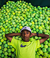 July 25, 2017 - Kartik Mandla, 11, poses for a portrait at the Eldon Roark Tennis Center in Whitehaven on Tuesday. Mandla, a rising tennis star from Collierville, is one of only 24 youths around the nation selected to train with the United States Tennis Association. (Yalonda M. James/The Commercial Appeal)