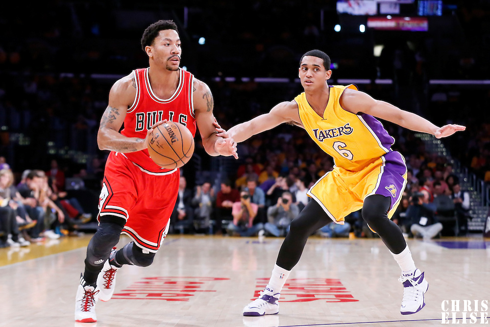 29 January 2015: Chicago Bulls guard Derrick Rose (1) drives past Los Angeles Lakers guard Jordan Clarkson (6) during the Los Angeles Lakers 123-118 2OT victory over the Chicago Bulls, at the Staples Center, Los Angeles, California, USA.