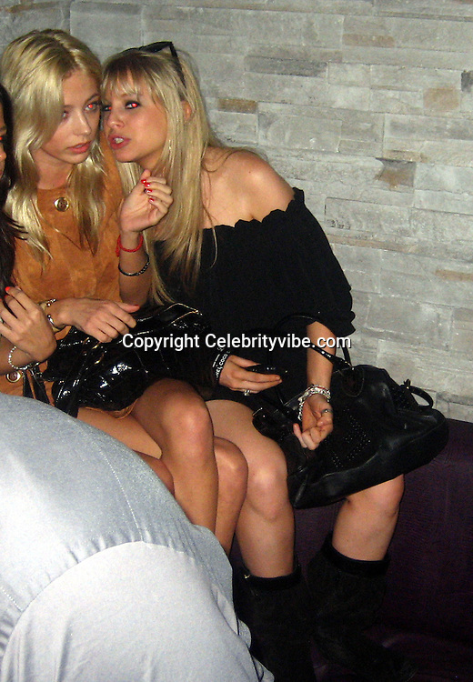 **EXCLUSIVE**.Brandon Davis' ex-girlfriend, Caroline Vreeland on the left.Even after months of been broken up Paris Hilton can't get over Stavros Niachors, because as soon as she arrived at Mokai Night Club, she went ballistic on Stavros and demanded that Brandon Davis' ex-girlfriend, Caroline Vreeland, who is having an affair with him, be removed from his table, telling her bodyguard to kick her out from the table. As soon as Brooke left, Paris started to make out with Stavros and to dance at the exactly place where Brooke was sitting..At the end Paris and Stavros made up and confess to each other how they can't live separately and that all the other affairs they had was just to spite each other...Mokai Nightclub.Miami Beach, FL, USA.Thursday, December 06, 2007 .Photo By Celebrityvibe.com.To license this image please call (212) 410 5354; or.Email: celebrityvibe@gmail.com ;.website: www.celebrityvibe.com