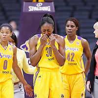 19 June 2014: Los Angeles Sparks forward Nneka Ogwumike (30) reacts as she is hurt, next to Los Angeles Sparks guard/forward Alana Beard (0) during the Los Angeles Sparks 87-77 victory over the Tulsa Shock, at the Staples Center, Los Angeles, California, USA.
