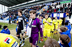 COLCHESTER, ENGLAND - Saturday, February 23, 2013: Tranmere Rovers' goalkeeper Owain Fon Williams enters the pitch alongside Colchester United's goalkeeper Sam Walker before the Football League One match at the Colchester Community Stadium. (Pic by Vegard Grott/Propaganda)