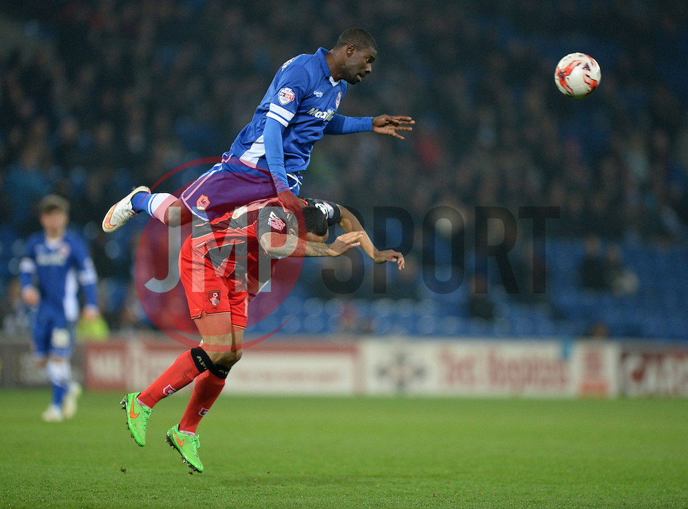 Cardiff City's Bruno Ecuele Manga wins a high ball and goes over the top of Cardiff City's Eoin Doyle - Photo mandatory by-line: Alex James/JMP - Mobile: 07966 386802 - 17/03/2015 - SPORT - Football - Cardiff - Cardiff City Stadium - Cardiff City v AFC Bournemouth - Sky Bet Championship
