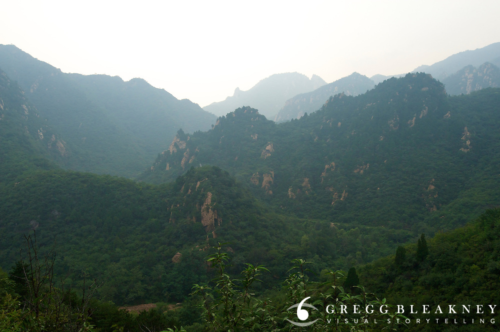 A view from the road near the summit of the highest of stage 3's 4 climbs (our Garmin clocked the summit at 770 meters) - Stage Three, 162km, Shangyu island to Yongning Town via Thirteen Ming Tombs Reservoir - 2011 Tour of Beijing Scouting Photos