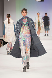 © Licensed to London News Pictures. 30/05/2015. London, UK. A model walks the runway during the Ravensbourne fashion show at Graduate Fashion Week 2015 wearing the collection of graduate student Cassandra Atcherley. Graduate Fashion Week takes place from 30 May to 2 June 2015 at the Old Truman Brewery, Brick Lane. Photo credit : Bettina Strenske/LNP