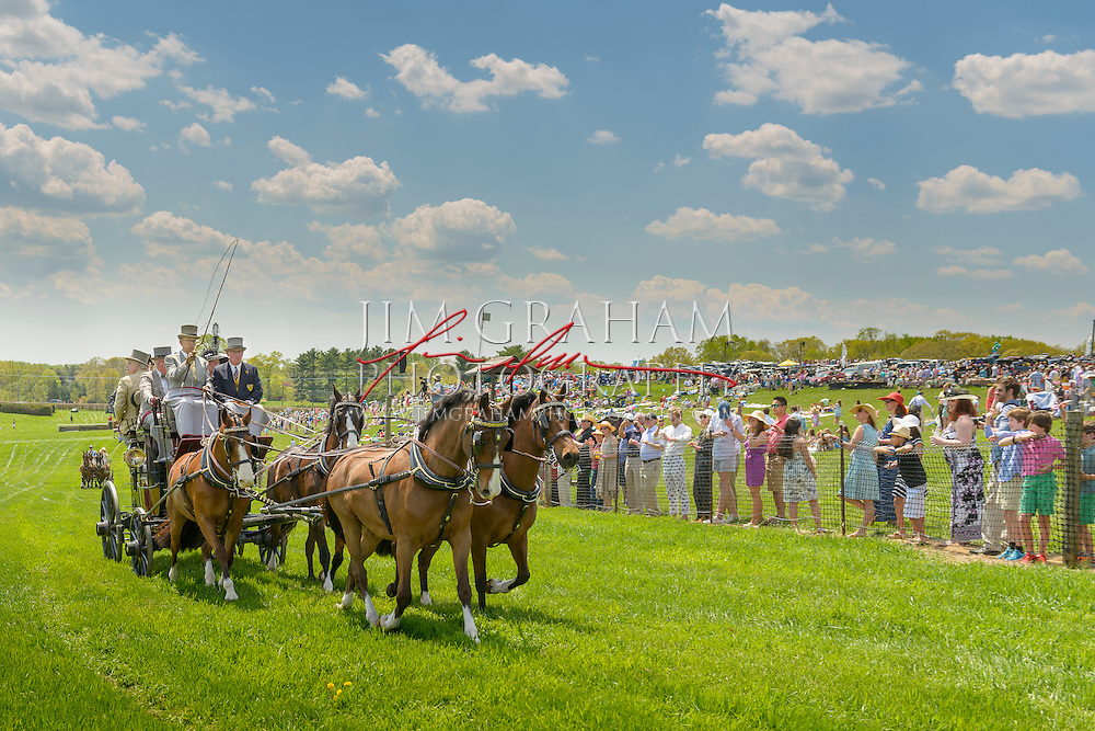 """George A. """"Frolic"""" Weymouth drives his road coach up the stretch at Winterthur's Point to Point races, a meet he helped found 37 years ago, Sunday 3 May 2015. Photography by Jim Graham"""