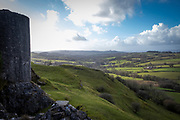 Dramatic landscape views of Carmarthenshire from Carreg Cennen Castle, Trapp, Brecon Beacons, Powys, UK.  The castle was built at the top of a limestone cliff, it is dated back to the 13th century, although there is archeological evidence of Roman and prehistoric occupation on the site. The castle has been in a ruinous state since 1462 and is under the care of Cadw, the Welsh Government historic environment service.  (photo by Andrew Aitchison / In pictures via Getty Images)