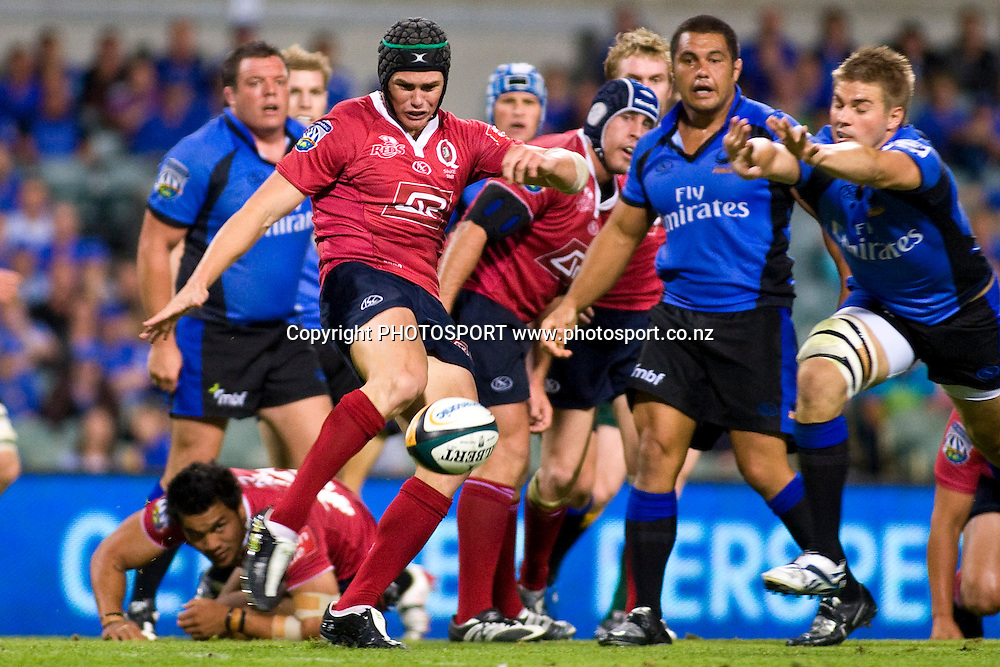 Berrick Barnes's kick is chased down by Drew Mitchell during the Super 14 rugby union match, Round 8, Western Force v Reds, Subiaco Oval, Perth, Australia, Friday, 3 April 2009. Score was Force 39 - Reds 7 in front of 15,724 fans. Photo: Christian Sprogoe/PHOTOSPORT
