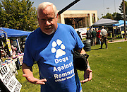 "John Yoakum wears a ""Dogs Against Romney"" shirt at The 16th annual Labor Day Picnic sponsored by Pima Area Labor Federation in Tucson, Arizona, USA, on September 3, 2012."