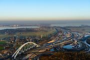 Nederland, Noord-Holland, Gemeente Muiden, 14-02-2017; Knooppunt Muiderberg, spoorbrug over de A1, de Zandhazenbrug in de avondschemering. Spoorlijn Almere-Amsterdam, Gooimeer.<br /> Muiderberg junction, near Amsterdam w railwaybridge.<br /> luchtfoto (toeslag op standard tarieven);<br /> aerial photo (additional fee required);<br /> copyright foto/photo Siebe Swart
