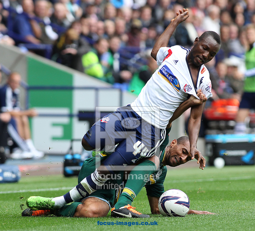 Picture by Michael Sedgwick/Focus Images Ltd +44 7900 363072<br /> 24/08/2013<br /> Mohamed Kamara of Bolton Wanderers and Karl Henry of Queens Park Rangers in action during the Sky Bet Championship match at the Reebok Stadium, Bolton.