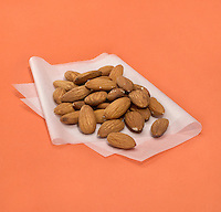 pile of almonds on wax paper