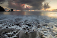 Sunset over Talisker Bay, Isle of Skye, Scotland.