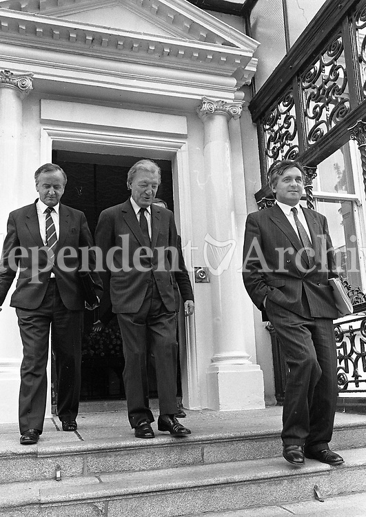 Acting Taoiseach Charles Haughey with Bertie Ahern and Joe Walsh leaving the Mansion House after talks with the Progressive Democrats, 01/07/1989 (Part of the Independent Newspapers Ireland/NLI Collection).