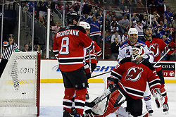 November 14, 2007; Newark, NJ, USA;  New Jersey Devils goalie Martin Brodeur (30) looks on as the New York Rangers celebrate a goal by New York Rangers defenseman Marc Staal (18) during the third period at the Prudential Center in Newark, NJ.
