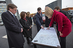 © Licensed to London News Pictures . 28/01/2013 . Manchester , UK . George Osborne (fourth from left) with Network Rail , HS2 and Manchester City Council delegates standing over a map of the proposed HS2 route in the car park at Manchester Piccadilly Train Station today (28th January 2013) as the government are due to reveal the proposed route for HS2 rail , linking Manchester , Leeds and Birmingham to London . Photo credit : Joel Goodman/LNP