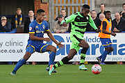 Lyle Taylor of AFC Wimbledon and Dale Bennett during the The FA Cup match between AFC Wimbledon and Forest Green Rovers at the Cherry Red Records Stadium, Kingston, England on 7 November 2015. Photo by Stuart Butcher.