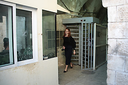 Jackie Pickersgill of UK charity MAP passes through a checkpoint in Hebron. From a series of photos commissioned by  British NGO, Medical Aid for Palestinians (MAP).