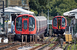© Licensed to London News Pictures. 15/09/2017. London, UK. Forensics officers can be seen next to the evacuated tube train (L) at Parsons Green Station after a small explosion during the morning rush hour. A number of casualties have been reported. Photo credit: Peter Macdiarmid/LNP