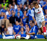 Photo: Daniel Hambury.<br />Chelsea v Portsmouth. The Barclays Premiership. 21/10/2006.<br />Chelsea's Arjen Robben and Portsmouth's Gary O'Neil battle.
