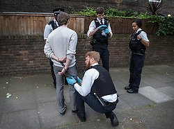 FILE IMAGE © Licensed to London News Pictures. 25/05/2018. London, UK. Police on a gang patrol in Islington search a man caught buying drugs. Photo credit: Peter Macdiarmid/LNP