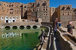 Women gather water from the cistern at Hababa, a medieval fortress village outside Sana, Yemen, March 14, 2012.