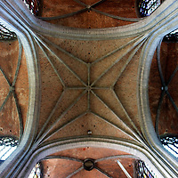 Looking up at the center section of the St. Walltrude collegiate church - the biggest cathedral in Mons and as one of the finest in Gothic cathederals anywhere in Belgium, one of Wallonia's most noteable monuments.