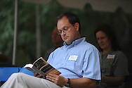 Jeff Busby follows along as a reader recites from The Reivers, written by Nobel Prize winning author William Faulkner, at the late writer's home of Rowan Oak in Oxford, Miss. on Friday, July 6, 2012. Faulkner died 50 years ago on July 6, 1962. Over 100 people are reading from the book to commemorate the occasion.