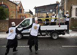 © Licensed to London News Pictures. 01/03/2018. London, UK. Young members of the Orthodox Jewish community  dance in the street as they celebrate the festival of Purim on the streets of Stamford Hill in north London on March 1, 2018. Purim celebrates the miraculous salvation of the Jews from a genocidal plot in ancient Persia, an event documented in the Book of Esther. Traditionally the jewish community wear fancy dress and exchange reciprocal gifts of food and drink. Photo credit: Ben Cawthra/LNP
