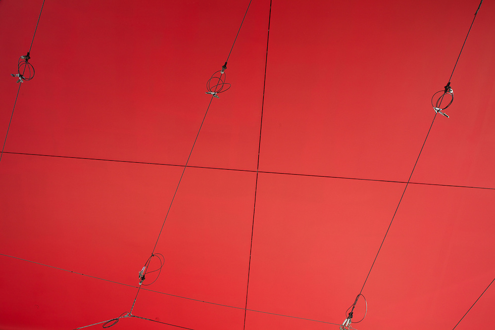 Toronto Transit streetcar power lines under a red panel ceiling at Dundas and Victoria Streets.