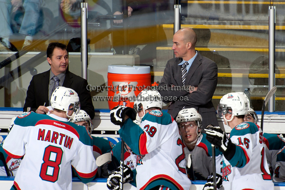 KELOWNA, CANADA -FEBRUARY 1: Dan Lambert, assistant coach and Ryan Huska, head coach of the Kelowna Rockets speak to players during a time out against the Kamloops Blazers on February 1, 2014 at Prospera Place in Kelowna, British Columbia, Canada.   (Photo by Marissa Baecker/Getty Images)  *** Local Caption *** Dan Lambert; Ryan Huska;