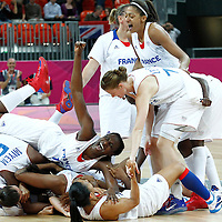 07 August 2012: Team France celebrates the win following 71-68 Team France victory over Team Czech Republic, during the women's basketball quarter-finals, at the Basketball Arena, in London, Great Britain.