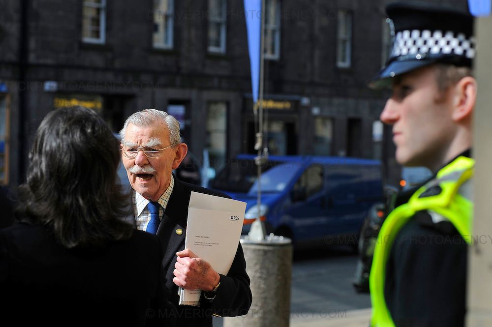 Shareholders of the Royal Bank of Scotland arrive at the Edinburgh International Conference centre to attend the companies annual general meeting on April 3rd, 2009 in Edinburgh, Scotland.  Shareholders are expected to express their anger at its past and present directors.  Pictured a shareholder expresses his anger to a reporter.