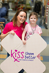 Jenny brings magic kisses to Temple Street .Maisie Casserly (age 5) is pictured with Jenny Kelly, Today FM presenter with her partner Ray D'arcy and busy mum of two as she visited Temple Street Children's Hospital to launch Kiss Them Better - the hospital's newest appeal to raise vital funds for emergency equipment.  She is asking mums everywhere to pick up a pack of Medicare Kiss Them Better plasters from their local pharmacies.  For every special pack bought, Medicare will make a donation to help sick children get better.  Picture Andres Poveda