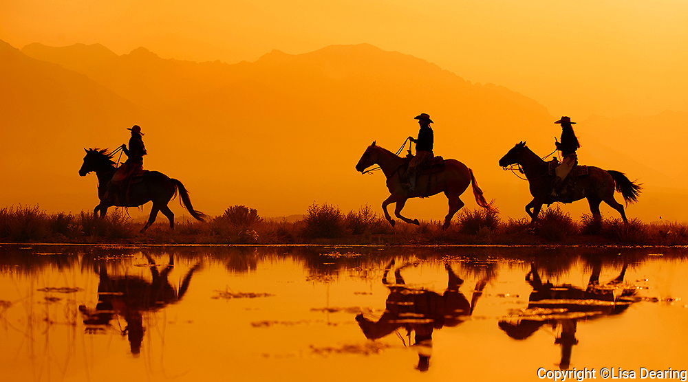 Three Cowgirls Riding at Pond