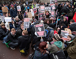 © under licence to London News Pictures 30/11/2010 Birmingham students marched to Birmingham Council House and entered the building earlier today. It is believed 30 students forced their way into the Council House. Picture shows students sitting down in New Street to block the traffic..Picture credit: Dave Warren/London News Pictures...
