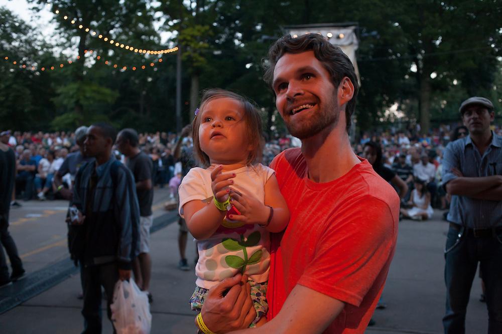 A man and his daughter watch and listen to Banda Magda at Celebrate Boroklyn!