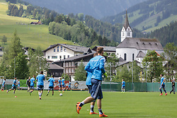 03.06.2015, Steinbergstadion, Leogang, AUT, U 21 EM, Vorbereitung Deutschland, im Bild die Spieler beim aufwärmen und trainieren dahiter die Kirche von Leogang // during Trainingscamp of Team Germany for Preparation of the UEFA European Under 21 Championship at the Steinbergstadium in Leogang, Austria on 2015/06/03. EXPA Pictures © 2015, PhotoCredit: EXPA/ JFK