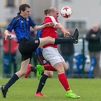 Bridge United's Jonathan Downes and Newmarket Celtic's Gary Higgin compete for the ball