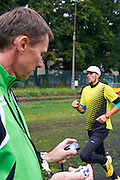 (R) Artur Kuciapski and (L) his trainer Andrzej Wolkowycki during training session on AWF at athletics stadium in Warsaw, Poland.<br /> <br /> Poland, Warsaw, August 26, 2014<br /> <br /> Picture also available in RAW (NEF) or TIFF format on special request.<br /> <br /> For editorial use only. Any commercial or promotional use requires permission.<br /> <br /> Photo by &copy; Adam Nurkiewicz / Mediasport