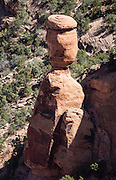 Balanced Rock, Colorado National Monument, near Grand Junction and Fruita, Colorado, USA. This desert land is high on the Colorado Plateau dotted with pinion and juniper forests.