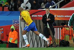 Football - soccer: FIFA World Cup South Africa 2010, Brazil (BRA) - Korea DPR (PRK), Dunga applaude Maicon