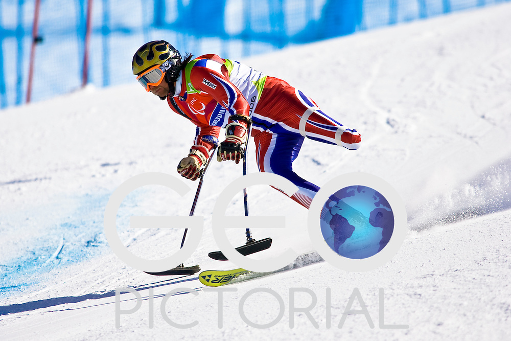 SESTRIERE COLLE, ITALY - MARCH  16th : Asle Tangvik (LW2) of Norway on his first run of the Mens Alpine Skiing Giant Slalom Standing competition on Day 6 of the 2006 Turin Winter Paralympic Games on March 16th, 2006 in Sestriere Borgata, Italy.