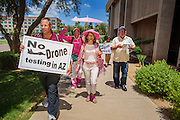 "31 JULY 2012 - PHOENIX, AZ:  MEDEA BENJAMIN, center, and other members of Code Pink march around the Arizona State Capitol Tuesday. Medea is a political activist, best known for co-founding Code Pink and, along with her husband, activist and author Kevin Danaher, the fair trade advocacy group Global Exchange. She was also a Green Party candidate in 2000 for the United States Senate. She appeared in Phoenix to promote her new book, ""Drone Warfare: Killing by Remote Control."" She, and other members of Code Pink, presented a letter to Arizona Gov. Jan Brewer protesting Brewer's request to use the state's airspace to train drone pilots.  PHOTO BY JACK KURTZ"