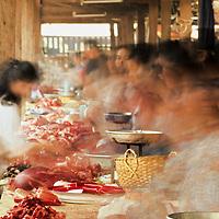 Women working and shopping at bustling meat market, Luang Phrabang, Laos
