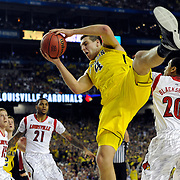 Atlanta, GA / 2013 - Michigan's Mitch McGary grabs a rebound in the first half of the NCAA Final Four basketball championship game against Louisville at the Georgia Dome. Photo by Mike Roy/The Star-Ledger