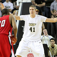 Central Florida center Tom Herzog (41) plays defense against Louisiana's center Courtney Wallace (20) during their game at the UCF Arena on December 15, 2010 in Orlando, Florida. UCF won the game79-58. (AP Photo/Alex Menendez)